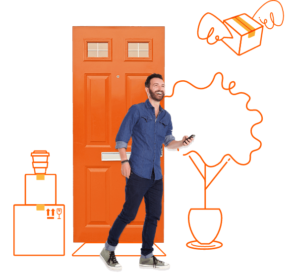 Man holding phone in front of orange door with moving boxes